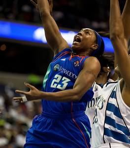 Star guard Cappie Pondexter of the New York Liberty goes up for a shot in front of Monique Currie of the Washington Mystics in WNBA action at the Verizon Center in Washington DC on August 20, 2010. The Washington Mystics defeated the New York Liberty 75-74 to move a win away from the Eastern Conference Regular Season Title and home court advantage in the early rounds of the playoffs. Pondexter led all scorers with 28 points. (Photo by Jeff Malet)