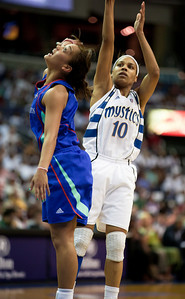 Lindsey Harding of the Washington Mystics shoots over New York Liberty guard Leilani Mitchell in WNBA action at the Verizon Center in Washington DC on August 20, 2010. The Washington Mystics defeated the New York Liberty 75-74 to move a win away from the Eastern Conference Regular Season Title and home court advantage in the early rounds of the playoffs. Harding scored 14 points for the Mystics. (Photo by Jeff Malet)
