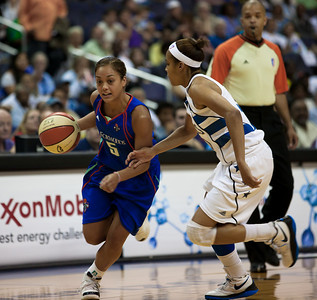 New York Liberty guard Leilani Mitchell drives against Lindsey Harding of the Washington Mystics in WNBA action at the Verizon Center in Washington DC on August 20, 2010. The Washington Mystics defeated the New York Liberty 75-74 to move a win away from the Eastern Conference Regular Season Title and home court advantage in the early rounds of the playoffs.  (Photo by Jeff Malet)