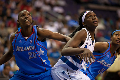 Sancho Lyttle and Angel McCoughtry of the Atlanta Dream and Crystal Langhorne of the Washington Mystics vie for a rebound in WNBA action at the Verizon Center in Washington DC on August 25, 2010. The Atlanta Dream upset the top-seeded Washington Mystics 95-90 in Game 1 of their Eastern Conference semifinal. Angel McCoughtry of the Dream led all scorers in the game with 28 points. Langhorne scored 16 for the Mystics. (Photo by Jeff Malet)