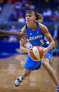 Coco Miller of the Atlanta Dream has the ball in WNBA action at the Verizon Center in Washington DC on August 25, 2010. The Atlanta Dream upset the top-seeded Washington Mystics 95-90 in Game 1 of their Eastern Conference semifinal. Coco Miller scored 21 in her first start of the season. Angel McCoughtry of the Dream led all scorers in the game with 28 points. (Photo by Jeff Malet)