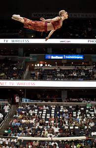 "Acrobat from the ""Russian Bar"" leaps high in the air during a half time exhibition at the Washington Mystics vs. NY Liberty basketball game on Aug. 20, 2010 at the Verizon Center in Washington DC on August 20, 2010. The Russian bar (or Russian barre) is a circus act which combines the gymnastic skills of the balance beam, the rebound tempo skills of trampoline and the swing handstands skills of the uneven bars and the parallel bars. The bar (or barre) itself is a flexible vaulting pole around 4 meters long, typically made of fiberglass. (Photo by Jeff Malet)"