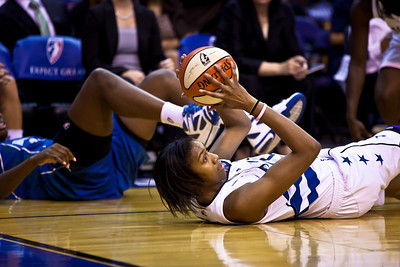 "Washington Mystics 6 '5"" Jacinta Monroe dives for ball in action against the Minnesota Lynx in a WNBA match at the Verizon Center in Washington DC on August 13, 2010. The Washington Mystics defeated the Minnesota Lynx 61-58. (Photo by Jeff Malet)"