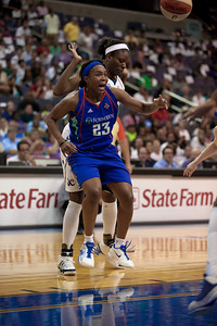 Star guard Cappie Pondexter of the New York Liberty is shadowed by  Nakia Sanford of the Washington Mystics in WNBA action at the Verizon Center in Washington DC on August 20, 2010. The Washington Mystics defeated the New York Liberty 75-74 to move a win away from the Eastern Conference Regular Season Title and home court advantage in the early rounds of the playoffs. Smith scored 12 points in the contest. Pondexter led all scorers with 28 points. (Photo by Jeff Malet)