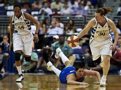 Katie Smith of the Washington Mystics leads a fast breakl in WNBA action at the Verizon Center in Washington DC on August 20, 2010.Janel McCarville of the New York Liberty falls to the ground in pursuit. The Washington Mystics defeated the New York Liberty 75-74 to move a win away from the Eastern Conference Regular Season Title and home court advantage in the early rounds of the playoffs. Smith scored 12 points in the contest. (Photo by Jeff Malet)