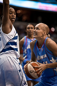 Yelena Leuchanka of the Atlanta Dream goes up for a score over Chasity Melvin of the Washington Mystics in WNBA action at the Verizon Center in Washington DC on August 25, 2010. The Atlanta Dream upset the top-seeded Washington Mystics 95-90 in Game 1 of their Eastern Conference semifinal. (Photo by Jeff Malet)
