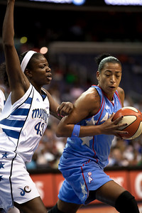 Erika Desouza of the Atlanta Dream drives past Nakia Sanford of the Washington Mystics in WNBA action at the Verizon Center in Washington DC on August 25, 2010. The Atlanta Dream upset the top-seeded Washington Mystics 95-90 in Game 1 of their Eastern Conference semifinal. Angel McCoughtry of the Dream led all scorers in the game with 28 points. Desouza scored 12.  (Photo by Jeff Malet)