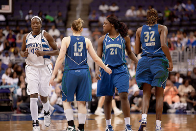 Washington Mystics Nakia Sanford crosses paths with Minnesota Lynx players Lindsay Whalen, Nicky Anosike and Rebekkah Brunson in a WNBA match at the Verizon Center in Washington DC on August 13, 2010. The Washington Mystics defeated the Minnesota Lynx 61-58. (Photo by Jeff Malet)