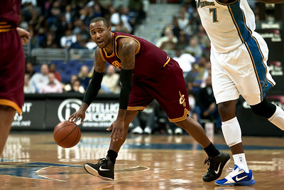 Mo Williams of the Cleveland Cavaliers is guarded by Andray Blatche of the Washington Wizards. Williams led all scorers with 28 points.