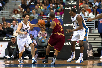 Mo Williams of the Cleveland Cavaliers tries to drive through Kirk Hinrich and John Wall of the Washington Wizards.