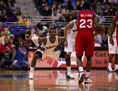 Louis Williams of the Philadelphia 76ers is guarded by John Wall of the Washington Wizards.