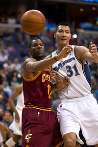 Joey Graham of the Cleveland Cavaliers and Yi Jianlian of the Washington Wizards vie for the ball. The Wizards were defeated 107-102  by the visiting Cavs at the Verizon Center in Washington DC on November 6, 2010.