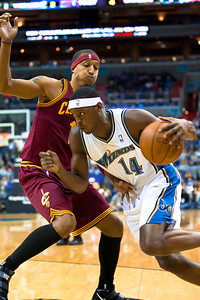 Al Thornton of the Washington Wizards is guarded by Daniel Gibson of the Cleveland Cavaliers.