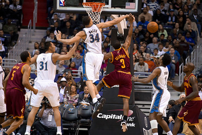 Ramon Sessions of the Cleveland Cavaliers is blocked by JaVale McGee of the Washington Wizards.
