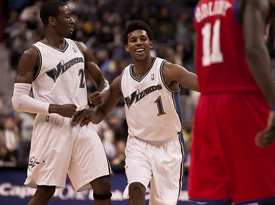Nick Young of the Washington Wizards celebrates a basket with teammate John Wall. The Wizards came back from a 15 point fourth-quarter deficit and defeated the Philadelphia 76ers in an overtime thriller at the Verizon Center in Washington DC on November 23, 2010. (Photo by Jeff Malet)