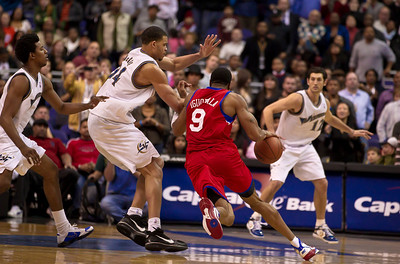 Andre Iguodala of the Philadelphia 76ers drives past JaVale McGee of the Washington Wizards during overtime.