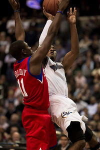 John Wall of the Washington Wizards goes up against Jrue Holiday of the Philadelphia 76ers. The Wizards came back from a 15 point fourth-quarter deficit and defeated the 76ers in an overtime thriller at the Verizon Center in Washington DC on November 23, 2010. (Photo by Jeff Malet)
