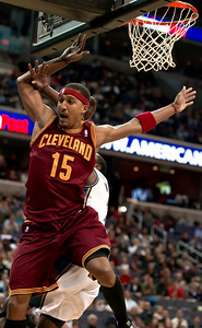 Jamario Moon of the Cleveland Cavaliers makes a strong move to the basket and takes a hard foul from John Wall of the Washington Waizards.