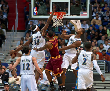 Daniel Gibson (1) of the Cleveland Cavaliers goes to the basket against Kirk Hinrich (12), Al Thornton (14), Hilton Armstrong (24) and John Wall (2) of the Washington Wizards. The Wizards were defeated 107-102  by the visiting Cavs at the Verizon Center in Washington DC on November 6, 2010.