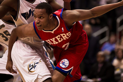 Evan Turner of the Philadelphia 76ers drives past Gilbert Arenas of the Washington Wizards late in the 4th quarter.