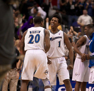 Nick Young and Cartier Martin  of the Washington Wizards celebrate a victory. Young earlier scored on a three point shot for the final go ahead points with 7.6 seconds remaining during overtime. The Wizards came back from a 15 point fourth-quarter deficit and defeated the Philadelphia 76ers in the overtime thriller at the Verizon Center in Washington DC on November 23, 2010. (Photo by Jeff Malet)