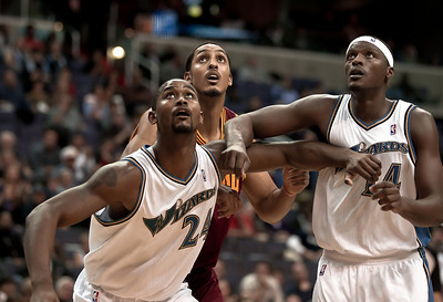 Hilton Armstrong, Al Thornton of the Washington Wizards and Ryan Hollins of the Cleveland Cavaliers watch for a potential rebound.