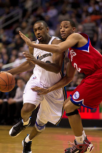 Gilbert Arenas of the Washington Wizards drives past Evan Turner of the Philadelphia 76ers during the overtime period. The Wizards came back from a 15 point fourth-quarter deficit and defeated the 76ers in an overtime thriller at the Verizon Center in Washington DC on November 23, 2010. (Photo by Jeff Malet)