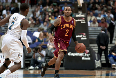 Mo Williams of the Cleveland Cavaliers is guarded by John Wall of the Washington Wizards.