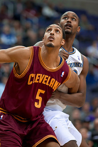 Ryan Hollins of the Cleveland Cavaliers fronts Hilton Armstrong of the Washington Wizards.