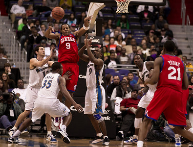 Andre Iguodala of the Philadelphia 76ers is guarded by Gilbert Arenas, Trevor Booker and Kirk Hinrich of the Washington Wizards.