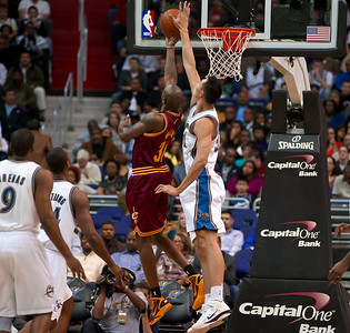 Jawad Williams of the Cleveland Cavaliers is blocked by Yi Jianlian of the Washington Wizards.