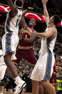 Daniel Gibson of the Cleveland Cavaliers goes up against Al Thornton of the Washington Wizards.