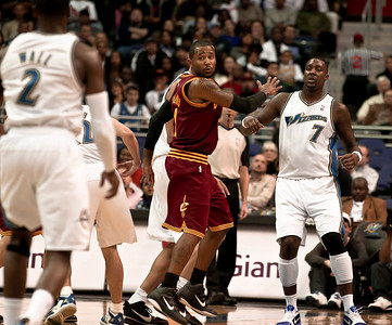 Daniel Gibson  of the Cleveland Cavaliers is surrounded by John Wall and Andray Blatche of the Washington Wizards.