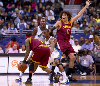 Anderson Varejao of the Cleveland Cavaliers looks for a pass from teammate  Daniel Gibson who is guarded by John Wall of the Washington Wizards. The Wizards were defeated 107-102  by the visiting Cavs at the Verizon Center in Washington DC on November 6, 2010.