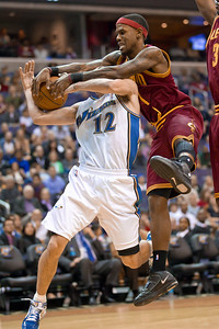 Kirk Hinrich of the Washington Wizards is fouled by Daniel Gibson of the Cleveland Cavaliers.