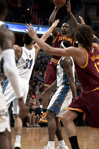 Jawad Williams of the Cleveland Cavaliers goes up against Yi Jianlian of the Washington Wizards.