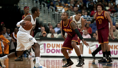John Wall of the Washington Wizards is guarded by Mo Williams of the Cleveland Cavaliers.
