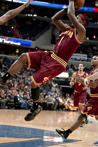 Daniel Gibson of the Cleveland Cavaliers takes a shot while falling to the floor.