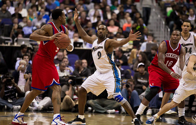 Andre Iguodala of the Philadelphia 76ers is guarded by Gilbert Arenas of the Washington Wizards.