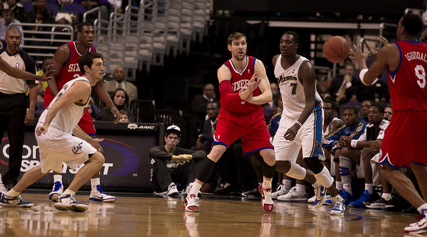 Andre Iguodala of the Philadelphia 76ers receives a pass from Andres Nocioni. Andray Blatche of the Washington Wizards looks on.