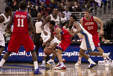 Andre Iguodala of the Philadelphia is trailed by Nick Young of the Washington Wizards. The Wizards came back from a 15 point fourth-quarter deficit and defeated the 76ers in an overtime thriller at the Verizon Center in Washington DC on November 23, 2010. (Photo by Jeff Malet)