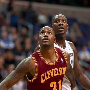Jawad Williams of the Cleveland Cavaliers fronts Hilton Armstrong of the Washington Wizards.