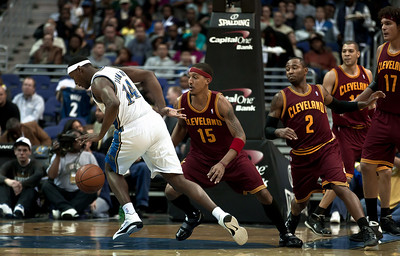 Al Thornton of the Washington Wizards is guarded by Jamario Moon and Mo Williams of the Cleveland Cavaliers.