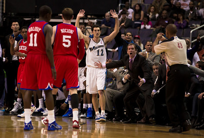 Head Coach  Flip Saunders of the Washington Wizards protests a call against #12 Kirk Hinrich.