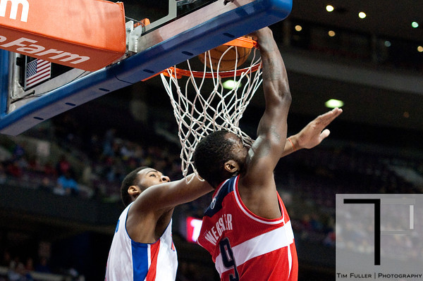 Dec 21, 2012; Auburn Hills, MI, USA; Washington Wizards small forward Martell Webster (9) slam dunks over Detroit Pistons center Andre Drummond (1) during the first quarter at The Palace. Mandatory Credit: Tim Fuller-USA TODAY Sports