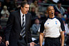 Dec 21, 2012; Auburn Hills, MI, USA; Washington Wizards head coach Randy Wittman (left) talks to referee Michael Smith (right) during the third quarter against the Detroit Pistons at The Palace. Pistons won 100-68. Mandatory Credit: Tim Fuller-USA TODAY Sports