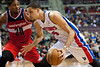 Dec 21, 2012; Auburn Hills, MI, USA; Detroit Pistons power forward Austin Daye (5) drives to the basket against Washington Wizards power forward Cartier Martin (20) during the fourth quarter at The Palace. Pistons won 100-68. Mandatory Credit: Tim Fuller-USA TODAY Sports