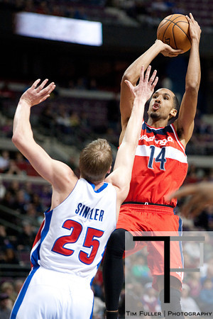 Dec 21, 2012; Auburn Hills, MI, USA; Detroit Pistons small forward Kyle Singler (25) guards Washington Wizards point guard Shaun Livingston (14) during the first quarter at The Palace. Mandatory Credit: Tim Fuller-USA TODAY Sports