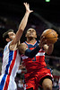 Feb 13, 2013; Auburn Hills, MI, USA; Washington Wizards shooting guard Bradley Beal (3) drives to the basket against Detroit Pistons point guard Jose Calderon (left) during the first quarter at The Palace. Mandatory Credit: Tim Fuller-USA TODAY Sports