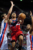 Feb 13, 2013; Auburn Hills, MI, USA; Washington Wizards shooting guard Bradley Beal (3) drives to the basket against Detroit Pistons point guard Jose Calderon (left) and center Greg Monroe (10) during the first quarter at The Palace. Mandatory Credit: Tim Fuller-USA TODAY Sports